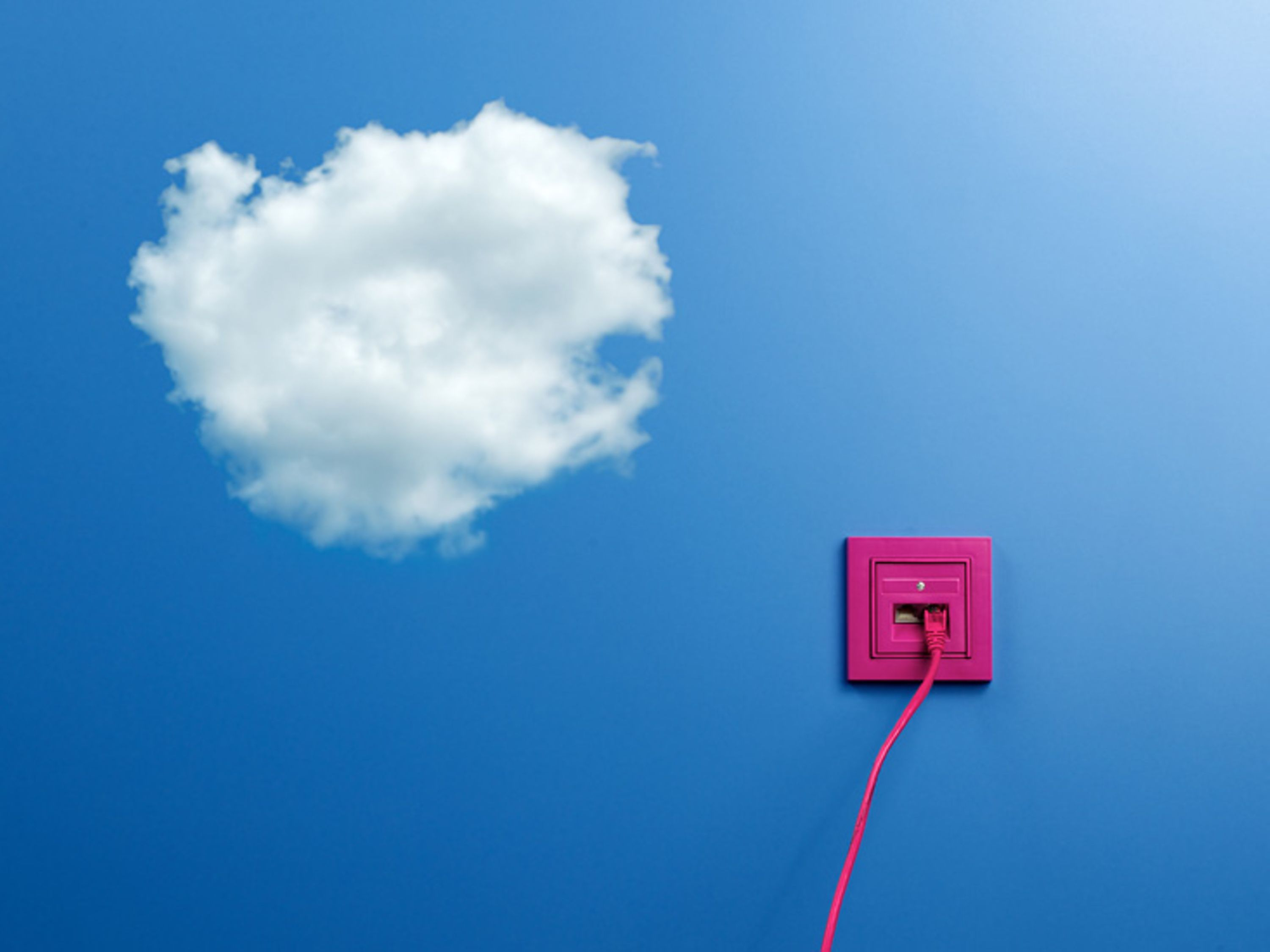 A pink outlet on a blue wall with clouds