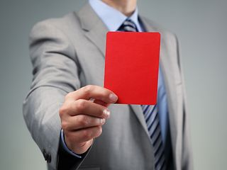 Man showing a read card.