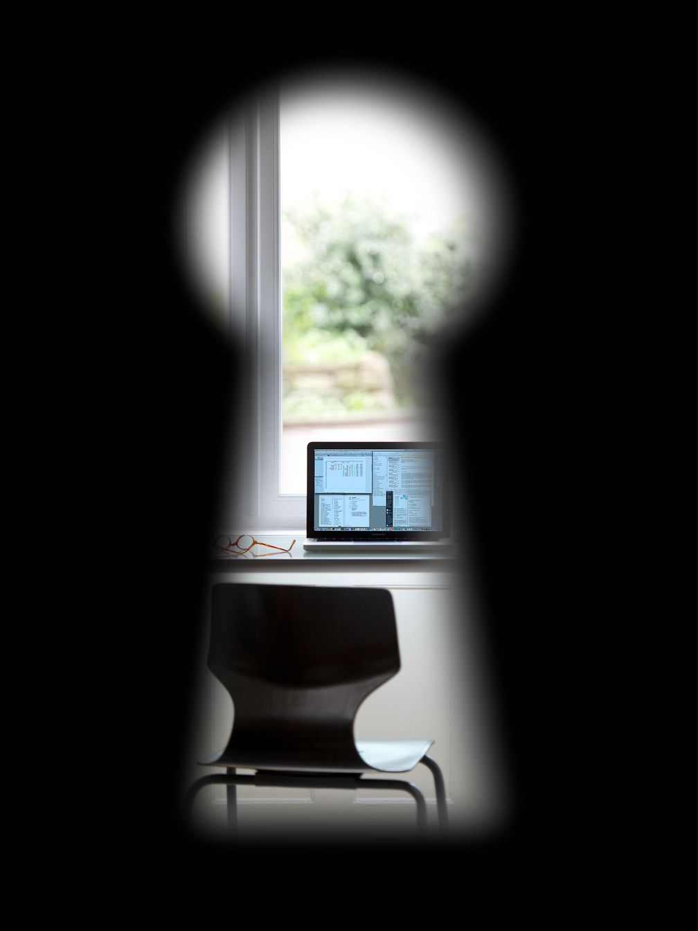 View through a keyhole on a laptop