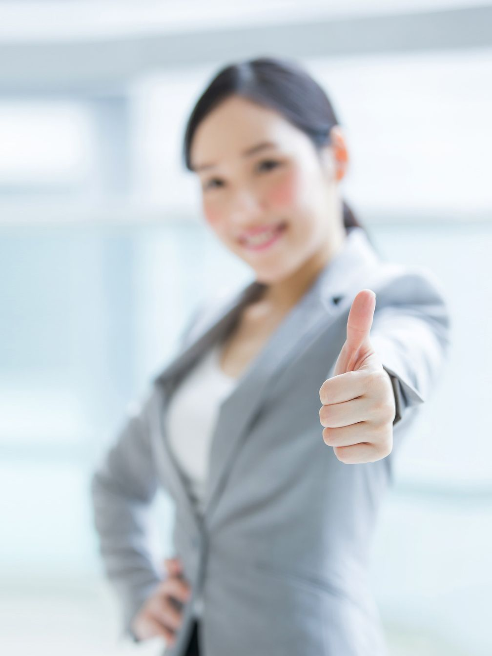 "Woman showing ""thumbs up""."