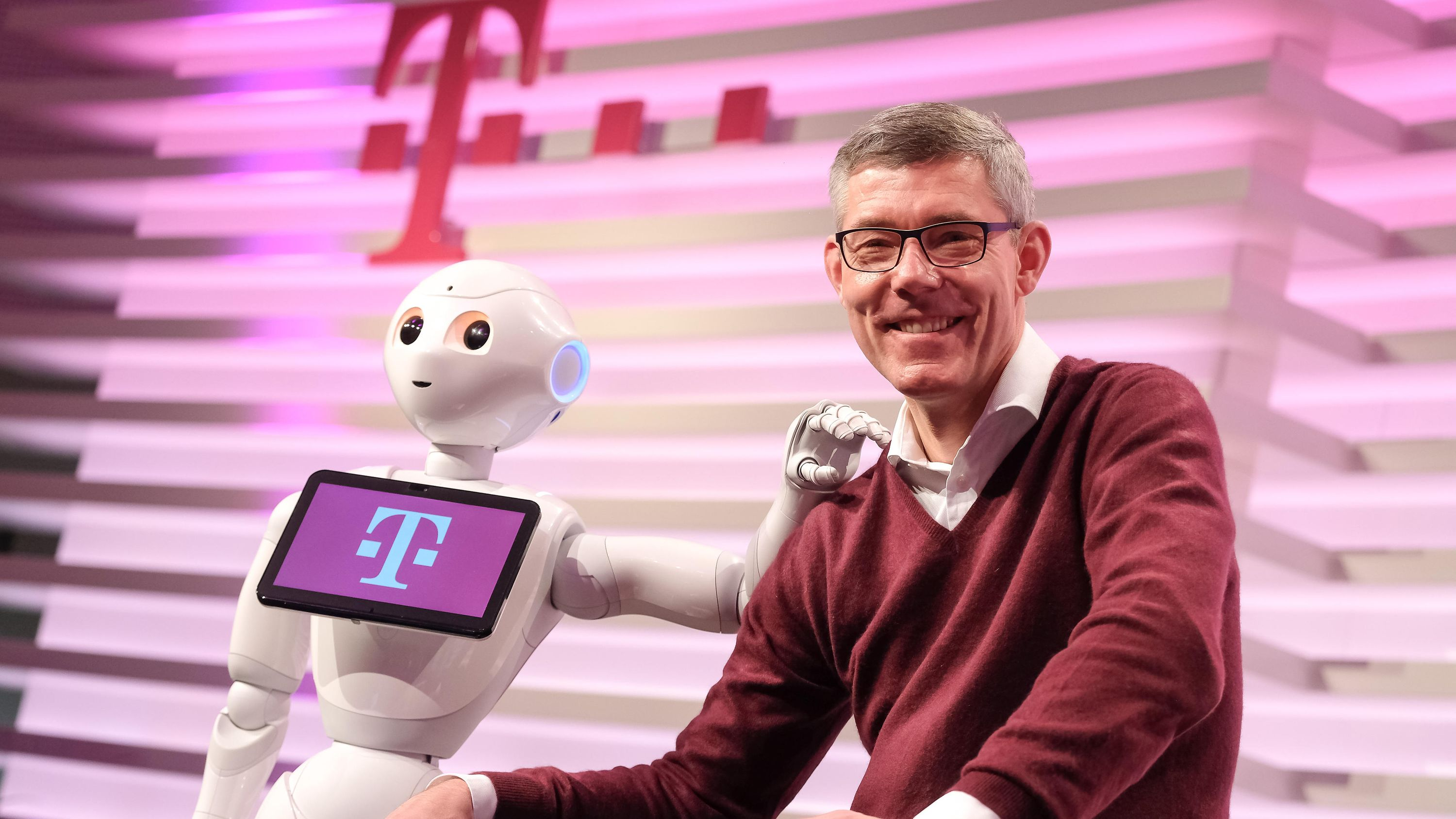 "Telekom Chief Human Resources Officer Christian P. Illek and Robot ""Pepper""."