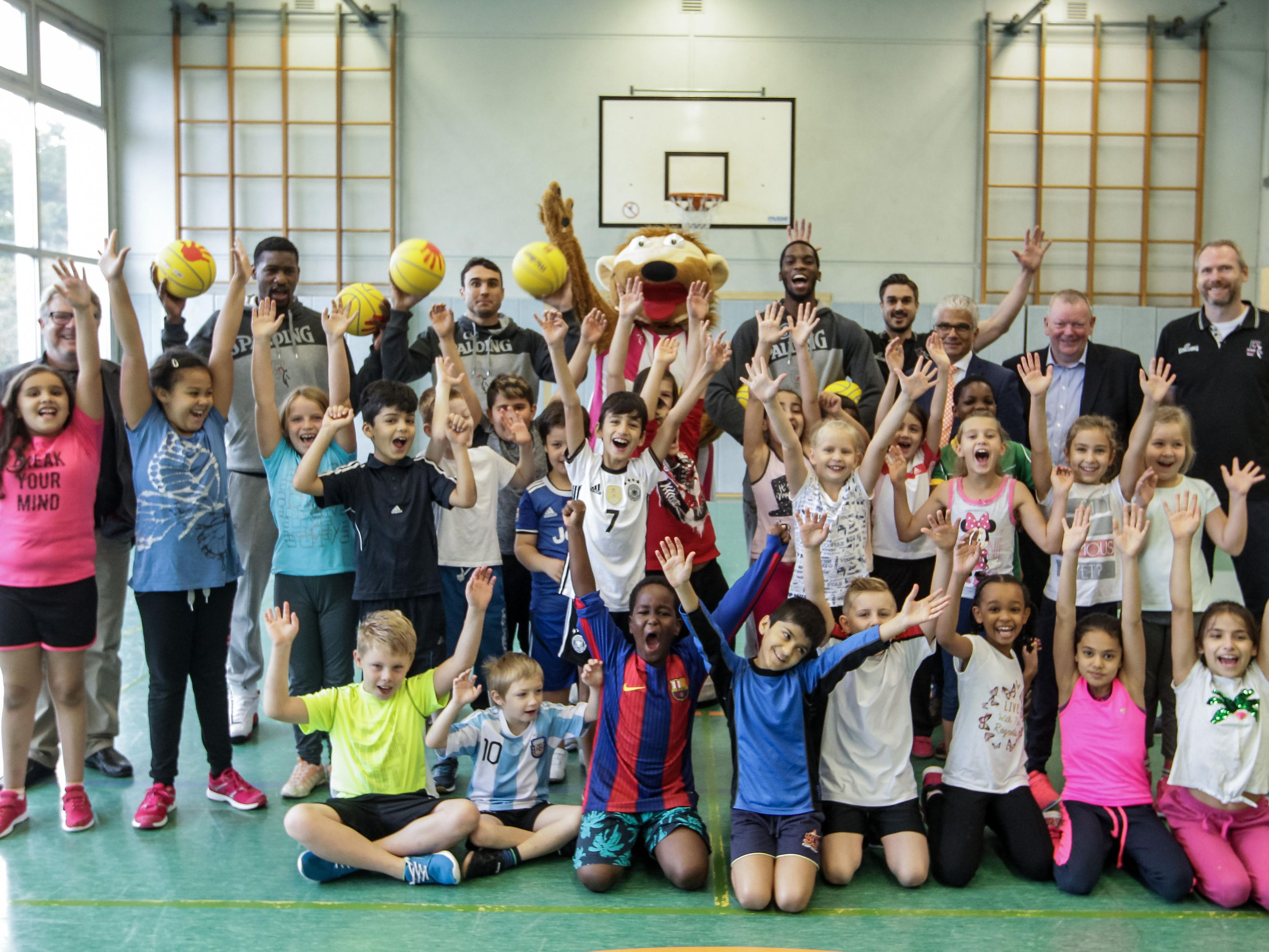 The children's excitement for the sport of basketball can be seen on the group photo taken for the event.