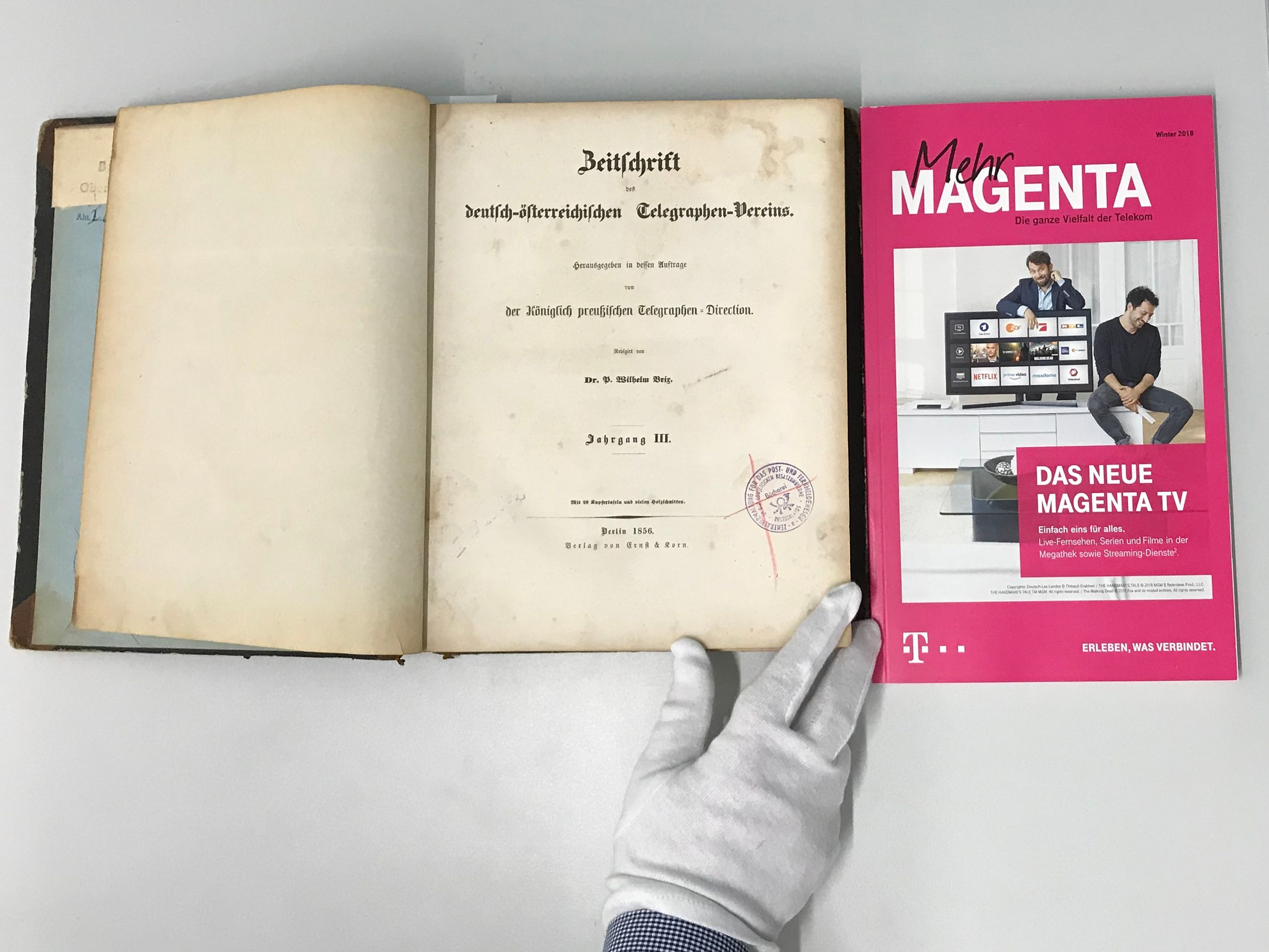 "The German-Austrian Telegraphic Union's magazine and the product magazine ""Mehr Magenta"" (More Magenta)."