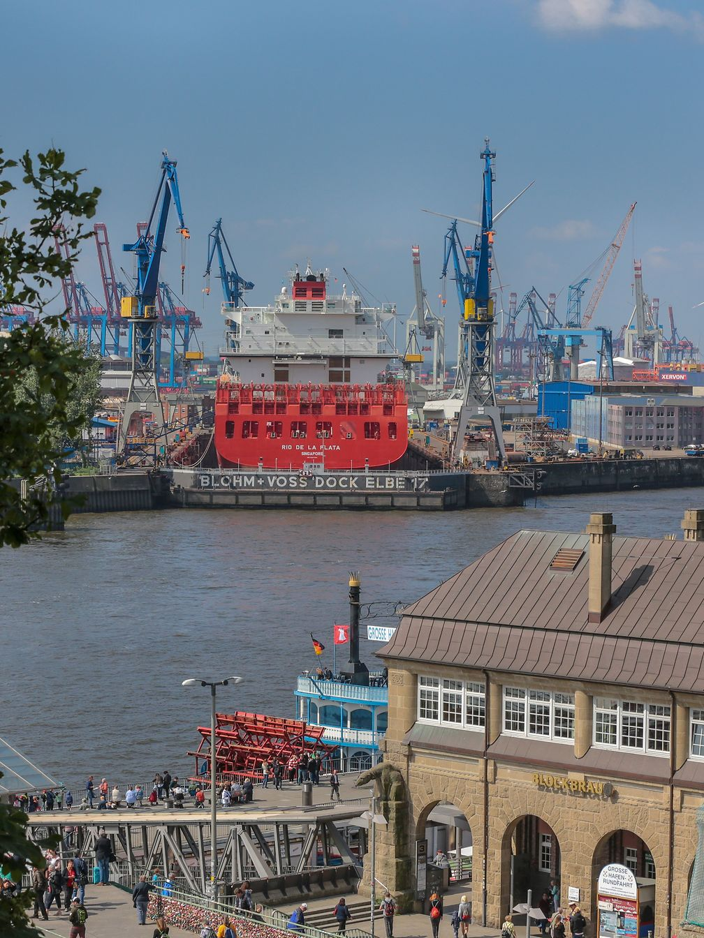 The picture shows the port of Hamburg with all its cranes.