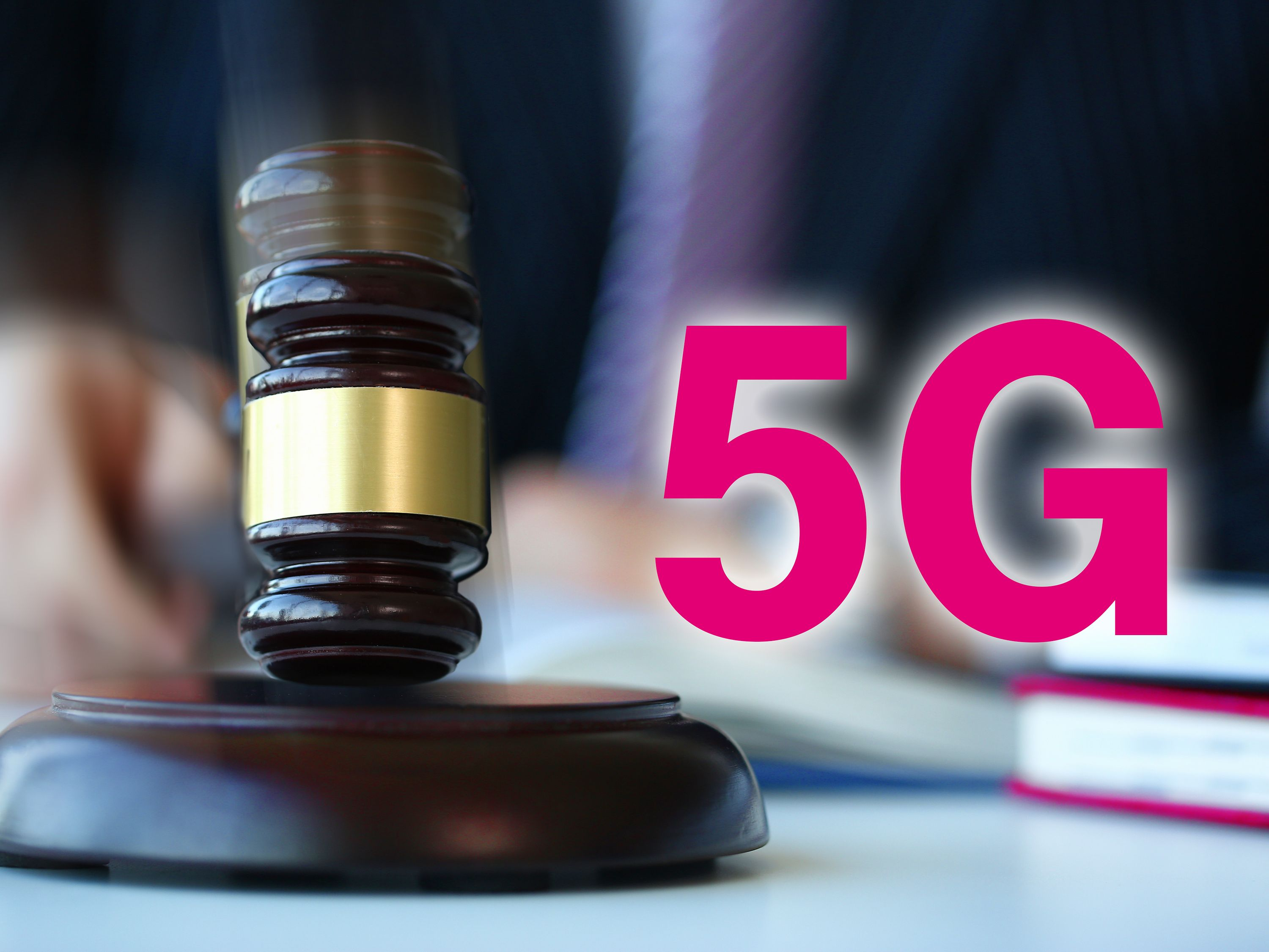 "Gavel, next to the letters ""5G"""