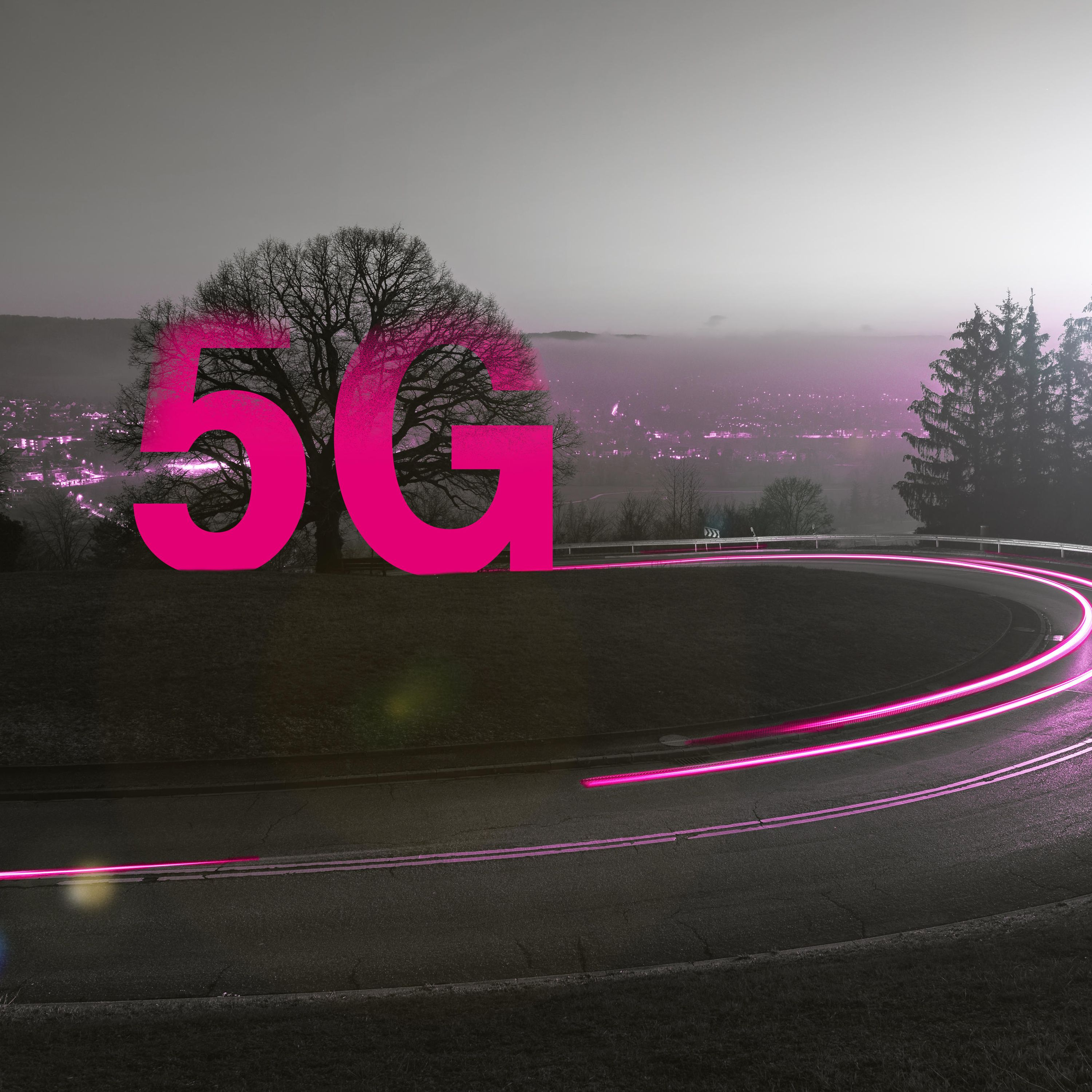 The lettering 5G stands over a street at dusk.