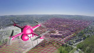 Medical transport drone over the skyline of Siegen. A magenta-colored grid indicates DTs campus network