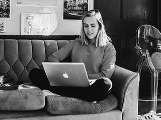 Student sitting with laptop on the sofa